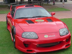 race car, automobile, automotive exterior, wheel, vehicle, performance car, bumper, toyota supra, land vehicle, supercar, sports car,