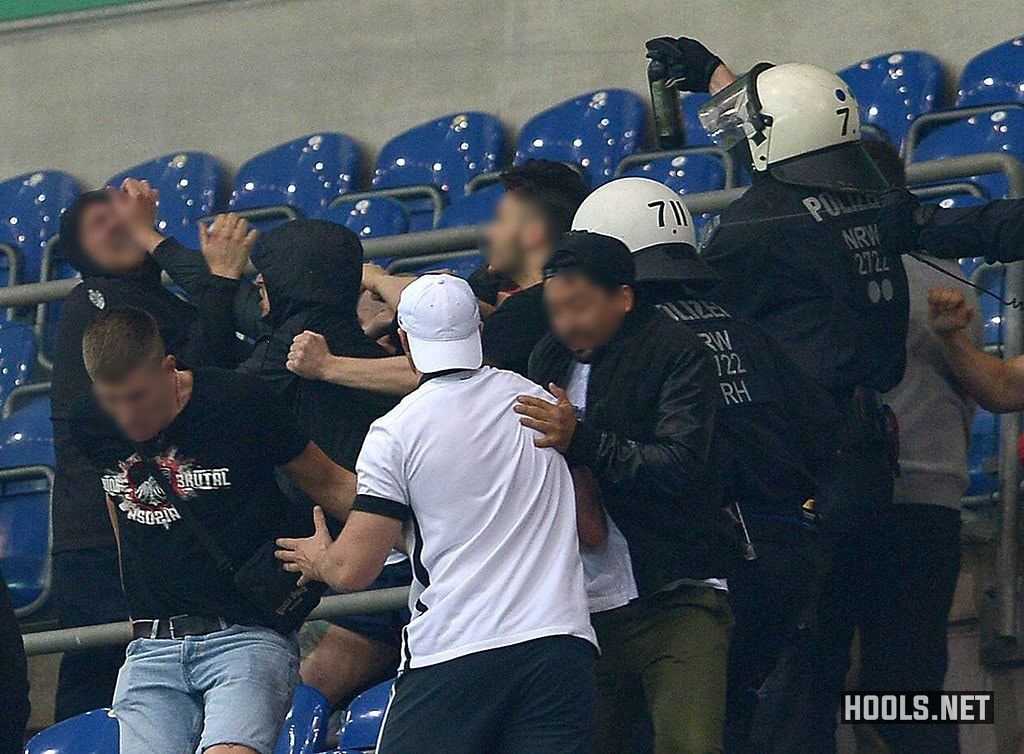 Schalke and Eintracht Frankfurt hooligans clash following the full-time whistle of their DFB Pokal match