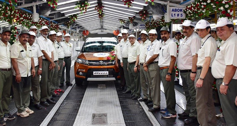 Mr Kenichi Ayukawa, MD&CEO (next to the car), is joined by Team Maruti Suzuki, as the 20millionth car rollsout from Company's Gurugram plant. Maruti Suzuki crossed cumulative production of 20million cars from its Gurugram&