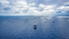 Multinational navy ships and submarines steam in formation during a group sail off the coast of Hawaii, July 26, as part of exercise Rim of the Pacific (RIMPAC). (U.S. Navy/MC1 Arthurgwain L. Marquez)