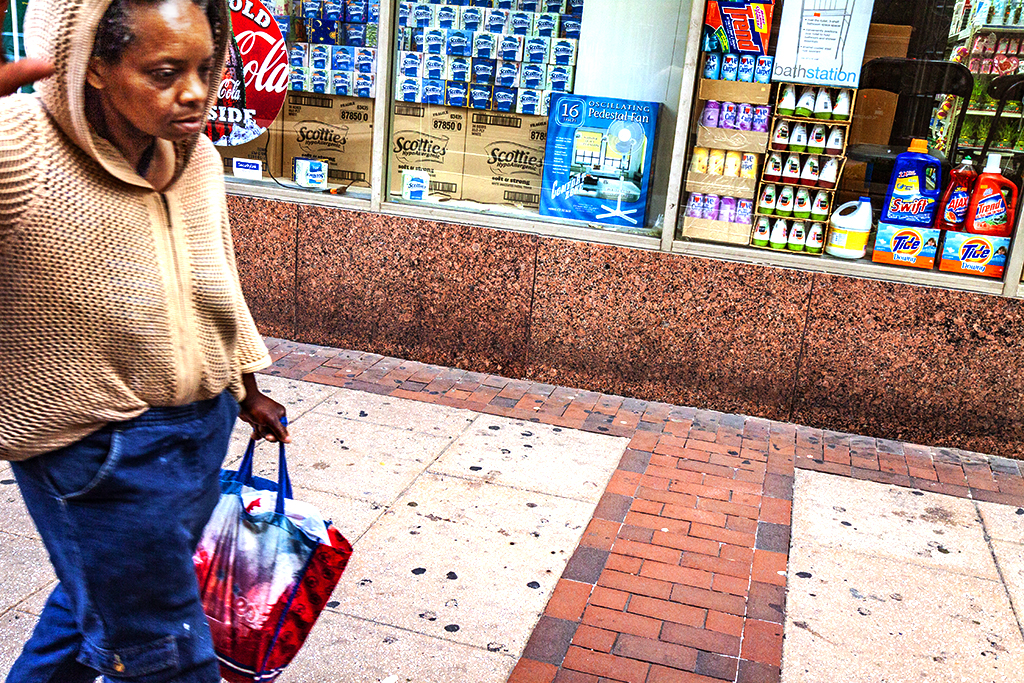 Woman walking by CVS--Center City