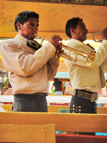 Mariachis playing at Xochimilco, the UNESCO Heritage Site of the former floating gardens in Mexico City