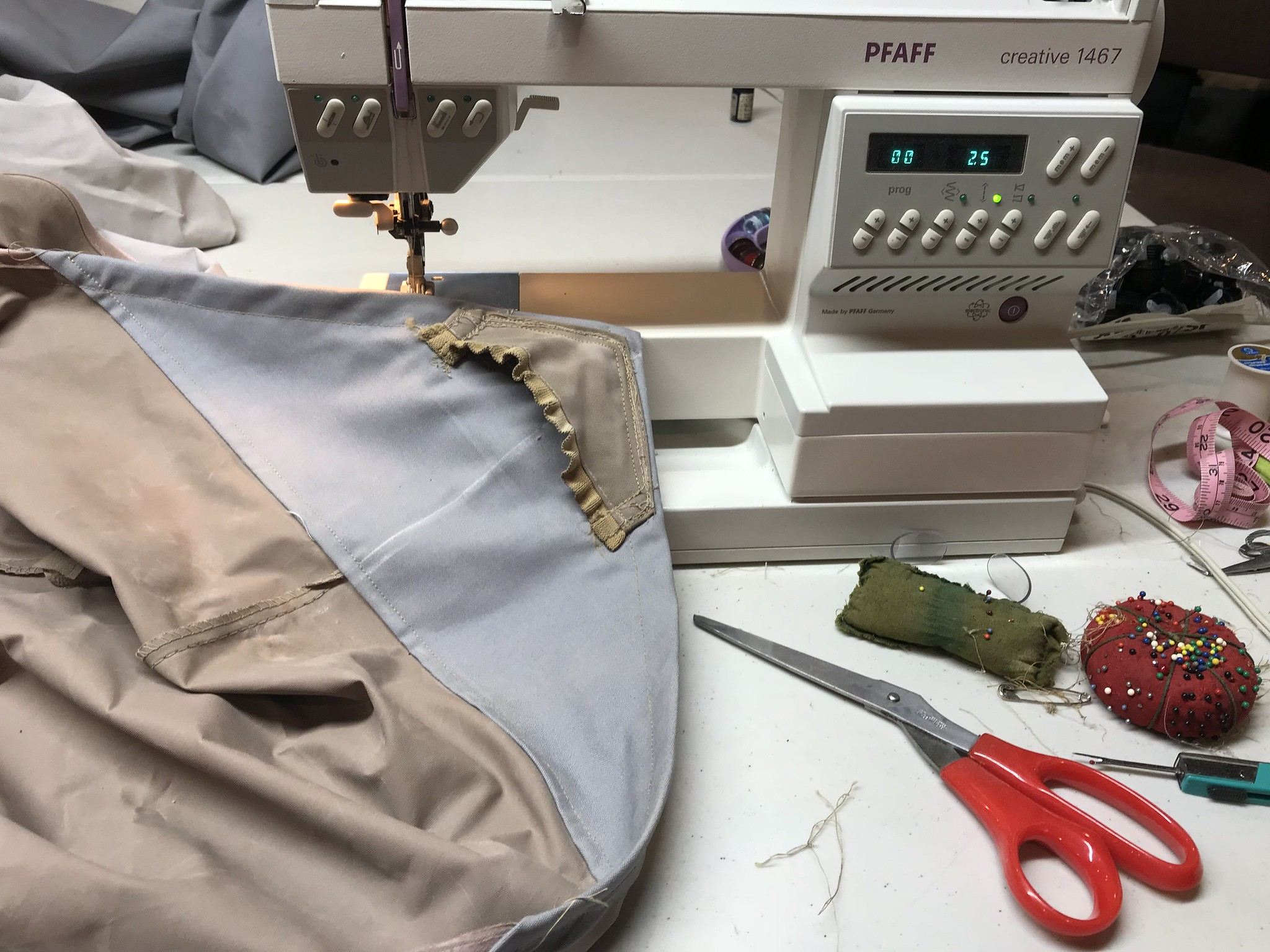 Sewing on a pocket to the canopy