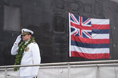 Cmdr. Sterling S. Jordan, commanding officer of USS Hawaii (SSN 776), salutes as he depart ship after a change of command ceremony, Aug. 2. (U.S. Navy/MC1 Daniel Hinton)