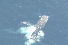The decommissioned frigate USS McClusky (FG 41) sinks after being struck with live fire during exercise RIMPAC. (U.S. Navy)