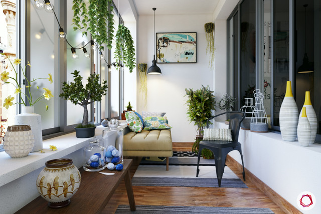 vases and artwork to bring color to the balcony garden