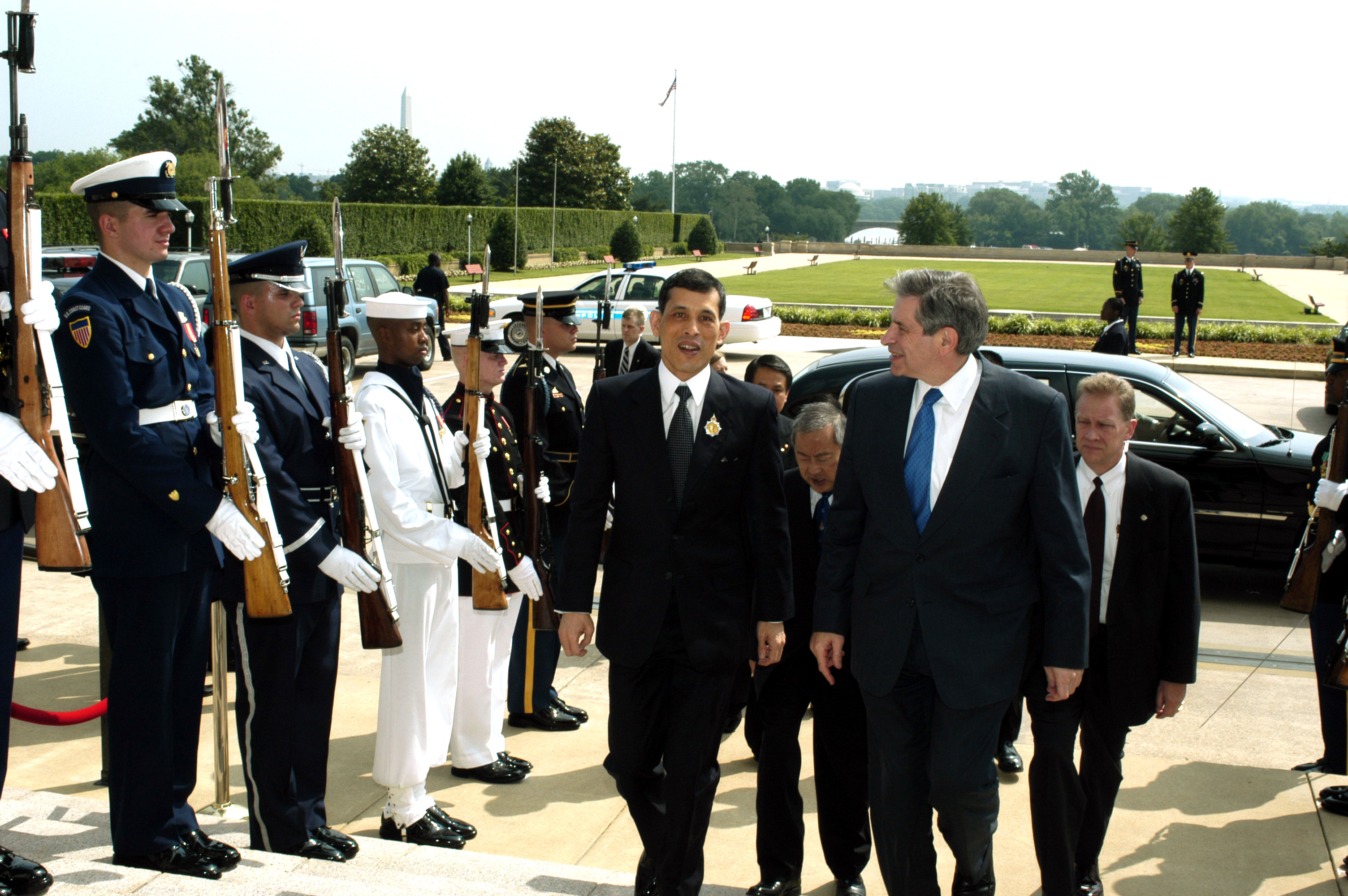 030612-D-2987S-002.Deputy Secretary of Defense Paul Wolfowitz (right) escorts Thailand's Crown Prince Maha Vajiralongkorn through an honor cordon and into the Pentagon on June 12, 2003. Wolfowitz and the Prince will meet to discuss a range of bilateral security issues and the global war on terror. DoD photo by Helene C. Stikkel. (Released) .
