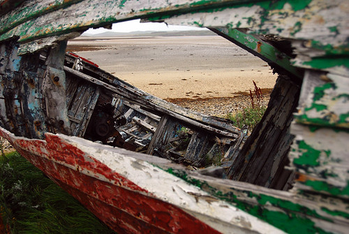 An abandoned boat at Traemore Beach, Ireland