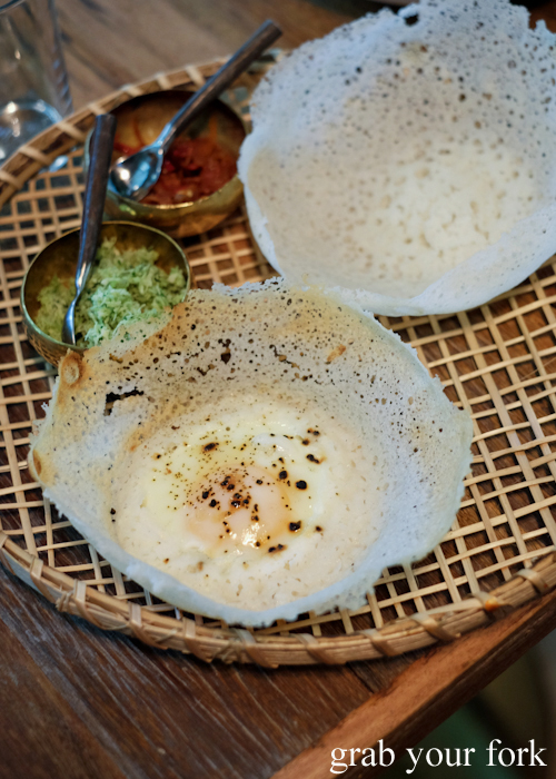 Egg hopper set with green pol sambol and kata sambol by O Tama Carey at Lankan Filling Station in East Sydney