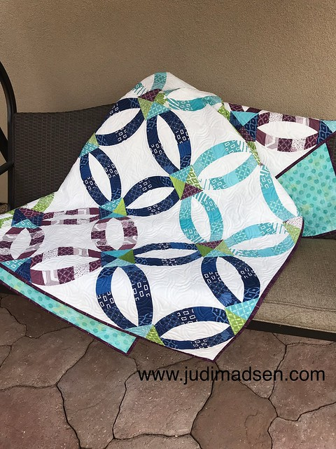 Sew Kind of Wonderful Metro Rings pieced and quilted by Judi Madsen using the Axel by Keryn Emmerson edge to edge quilting pattern.