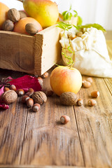 Autumn border from apples, pears and walnuts on old …