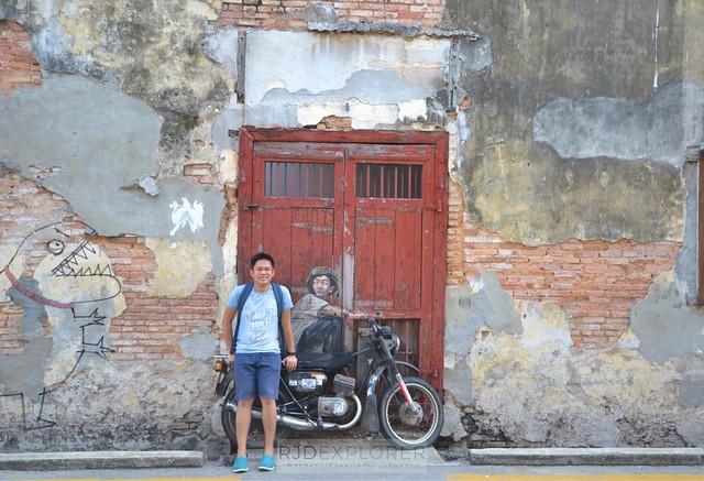 penang island itinerary travel guide Boy on a Motorcycle penang art