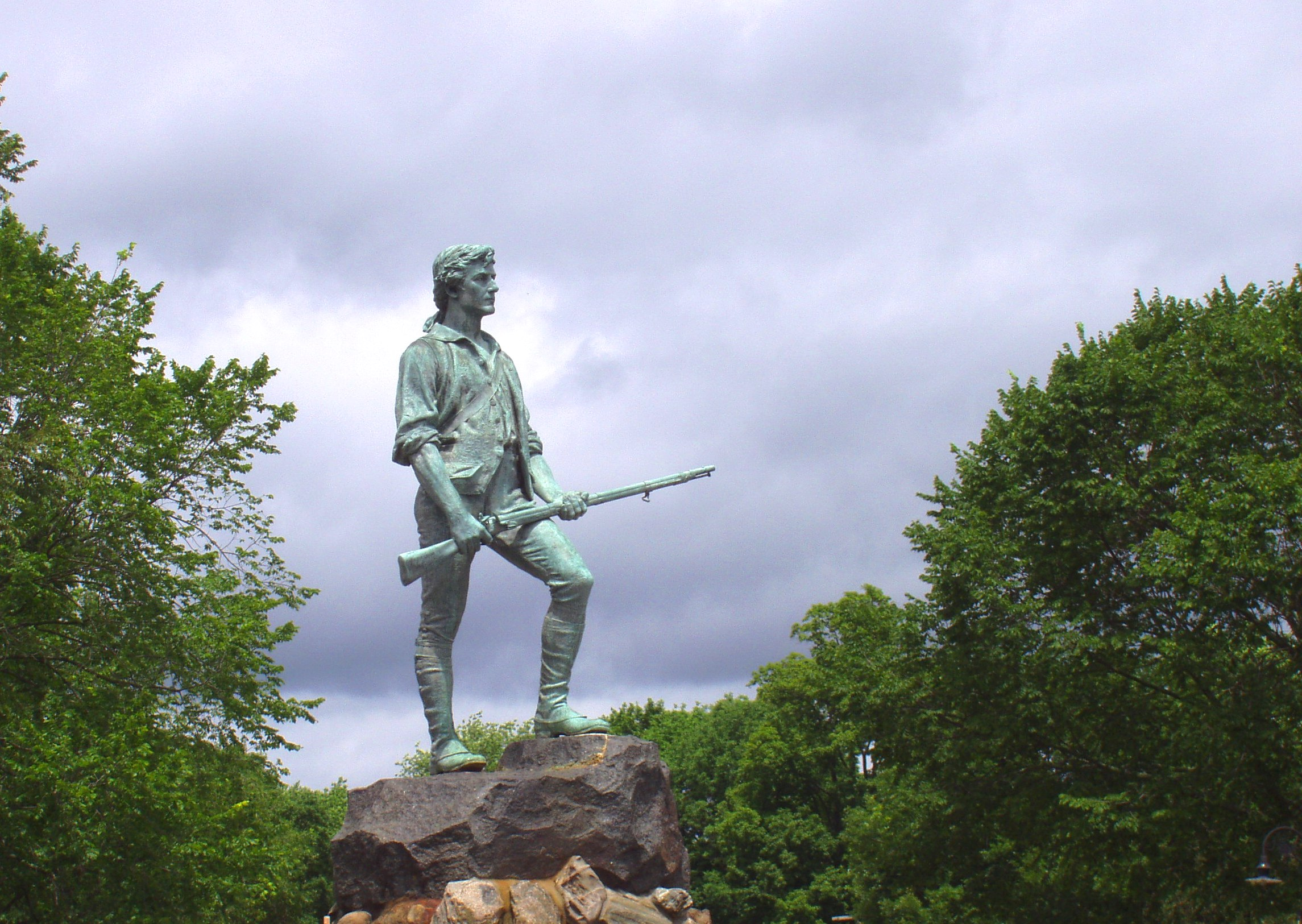 This statue known as The Lexington Minuteman is commonly believed to depict Captain John Parker. It is by Henry Hudson Kitson and stands at the town green of Lexington, Massachusetts.