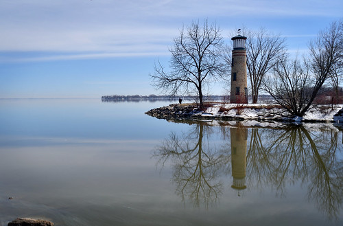 lake winnebago oshkosh wisconsin reflection water rocks trees snow lighthouse landscape