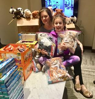 Rotary e-Club Houston member Cristal Montanez and granddaughter Kalleigh Joslin preparing Bear Hugs for Venezuela care packages