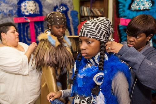 Wild Opelousas Big Chief Tycen gets help from his mother Takisha while Teacher Arias helps Big Queen Regine as the tribe prepares to show their suits their classmates and teachers on Febuary 8, 2017. Photo by rhrphoto.com.