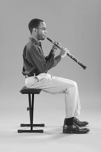 oboist sitting elegantly while playing