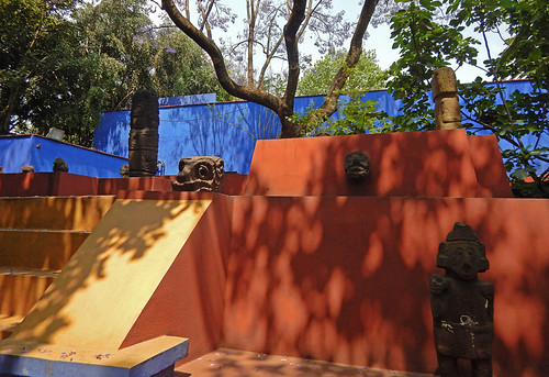 A dark red and gold pyramid in the garden of the artist Frida Kahlo's 'Casa Azul', the cobalt blue house in Coyoacán, Mexico