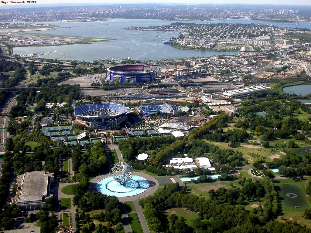 Aerial view of the former World's Fair Grounds showing the Flushing Meadows tennis stadiums used for the U.S. Open. Shea Stadium is in the background and the Unisphere is seen in the foreground.