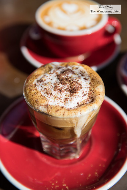 Macchiato topped with chai spices and edible gold glitter