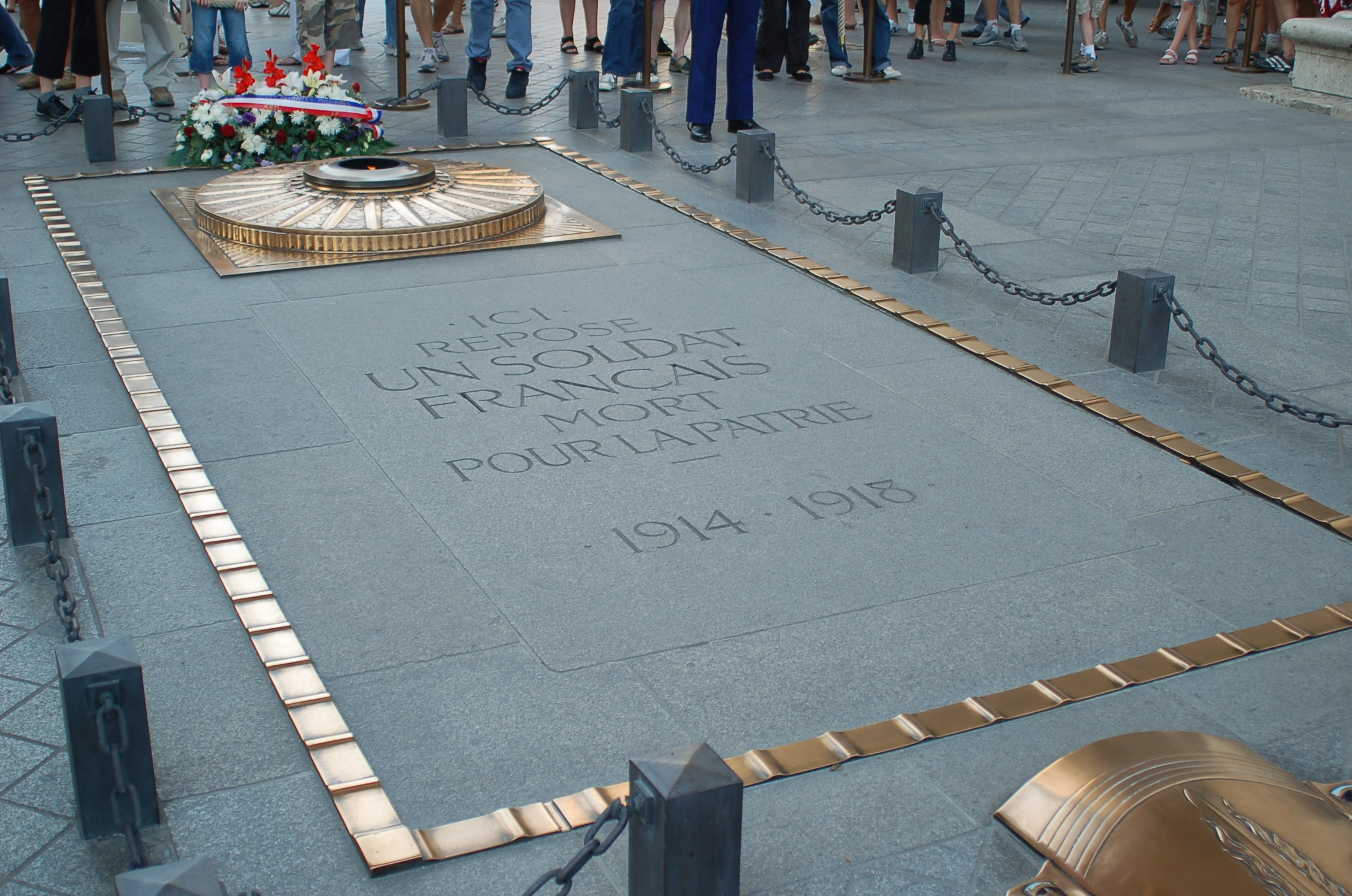 The tomb of the Unknown Soldier at Arc de Triomphe, Paris, France. Photo taken by Jérôme Blum on July 14, 2006.
