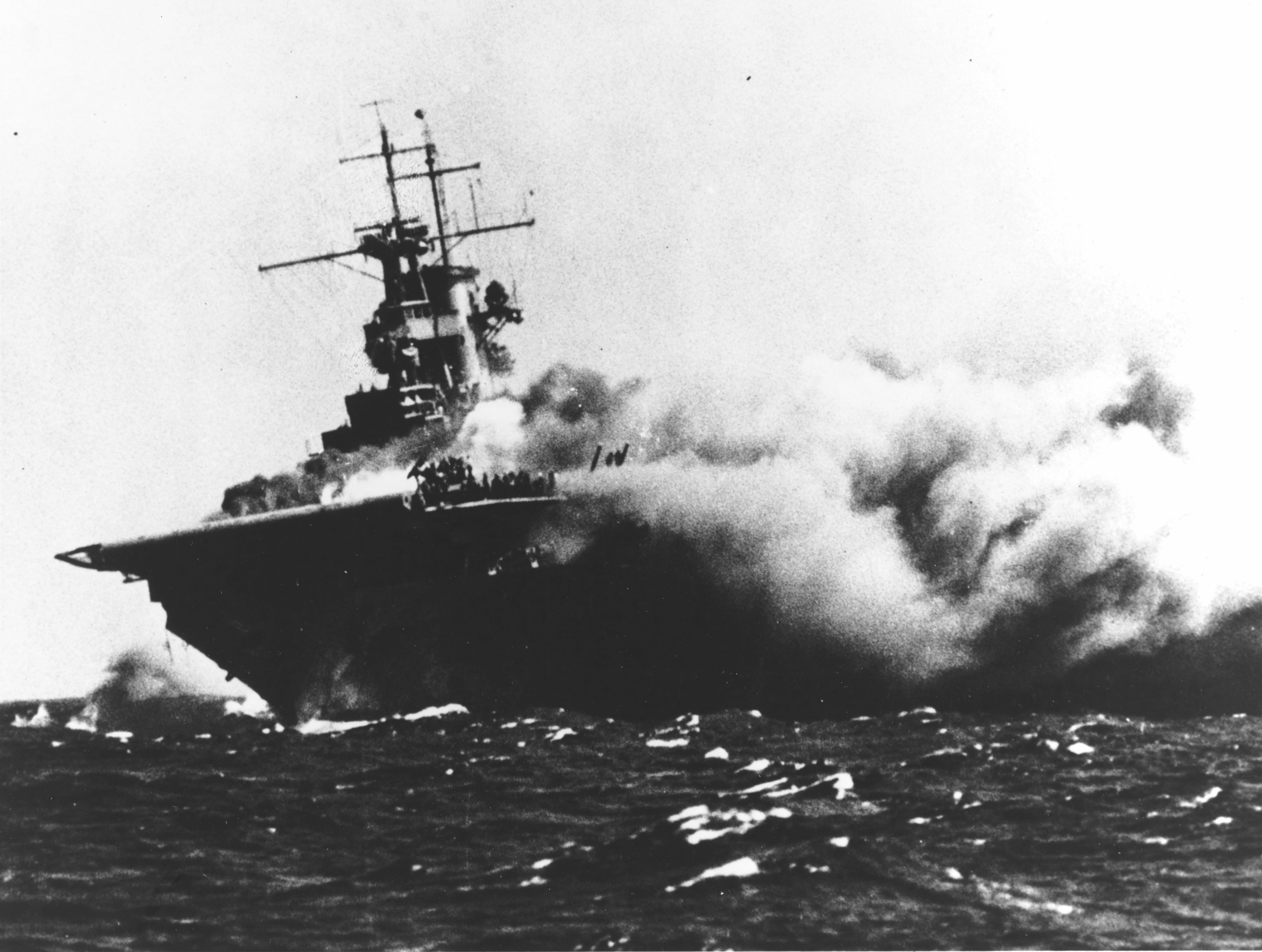 The U.S. Navy aircraft carrier USS Wasp (CV-7) burning and listing after she was torpedoed by the Japanese submarine I-19, on September 15, 1942, while operating in the Southwestern Pacific in support of forces on Guadalcanal. Note that the wartime censor has removed the CXAM-1 radar antenna, only its lower frame is still visible. U.S. Navy photo 80-G-16331.