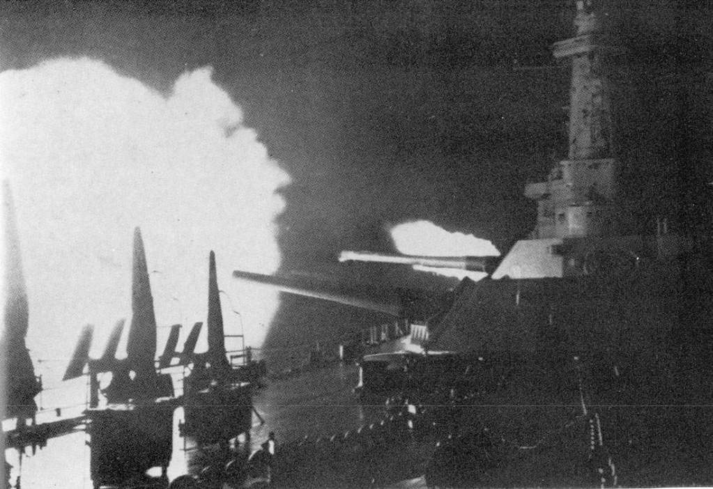 The U.S. battleship USS Washington (BB-56) firing upon the Japanese battleship Kirishima, during the Naval Battle of Guadalcanal on November 14-15, 1942. The low elevation of the barrels shows how the close range of the adversaries, only 7,700 m (8,400 yards), point blank range for the 406mm/45 caliber main armament of Washington.