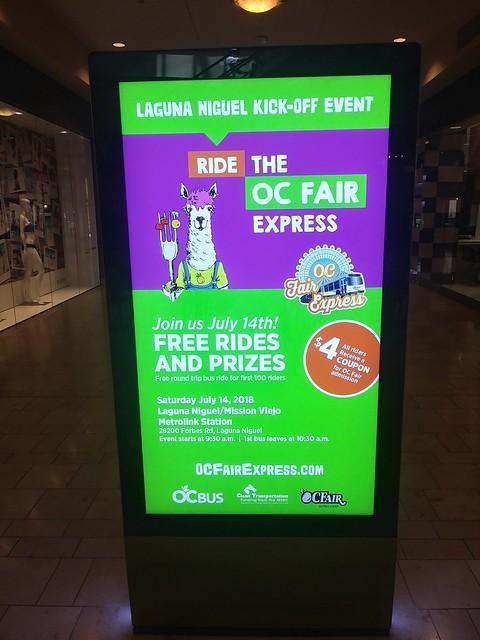 Ad on kiosks at Laguna Hills Mall promoting the OC Fair Express bus to the OC Fair
