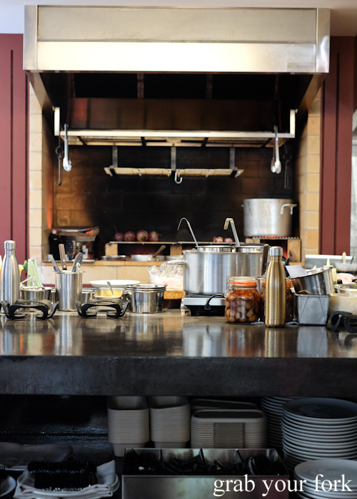 The open kitchen with woodfired grill at Poly by Mat Lindsay in Surry Hills