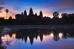 Angkor Wat at dusk with reflecting in water, Siem Reap Cambodia