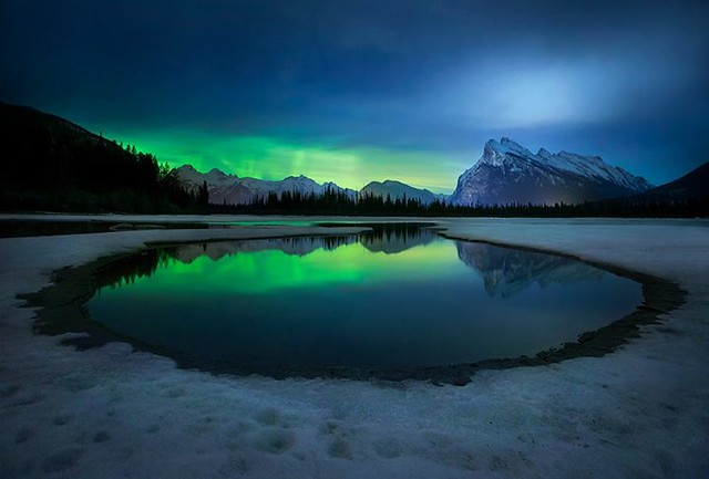 Smoke and Mirrors... We had a nice visit form the northern lights last night here in Banff. Unfortunately the clouds decided to show up too! A beautiful night in the mountains nonetheless! Vermilion Lakes, Banff National Park.