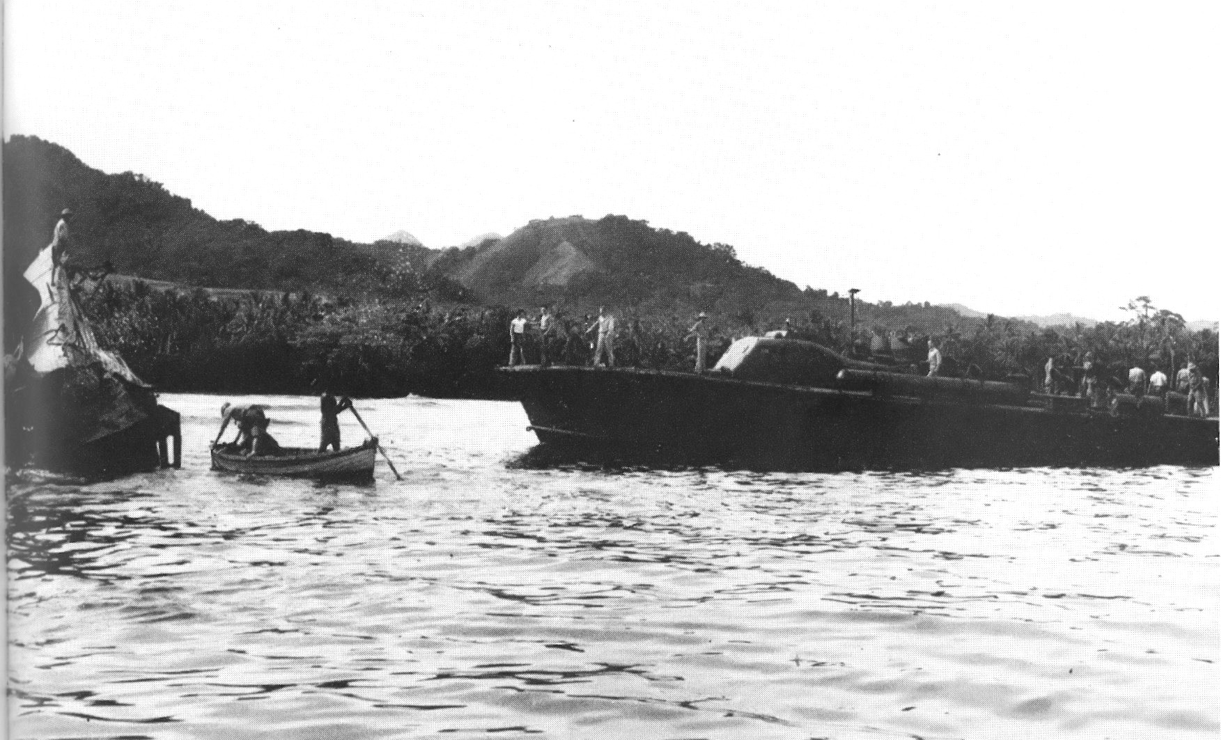 The crew of U.S. PT boat PT-59 inspects the wreckage of Japanese submarine I-1 at Kamimbo on Guadalcanal, February, 1943. I-1 had been sunk during January 1943 by HMNZS Kiwi and HMNZS Moa.