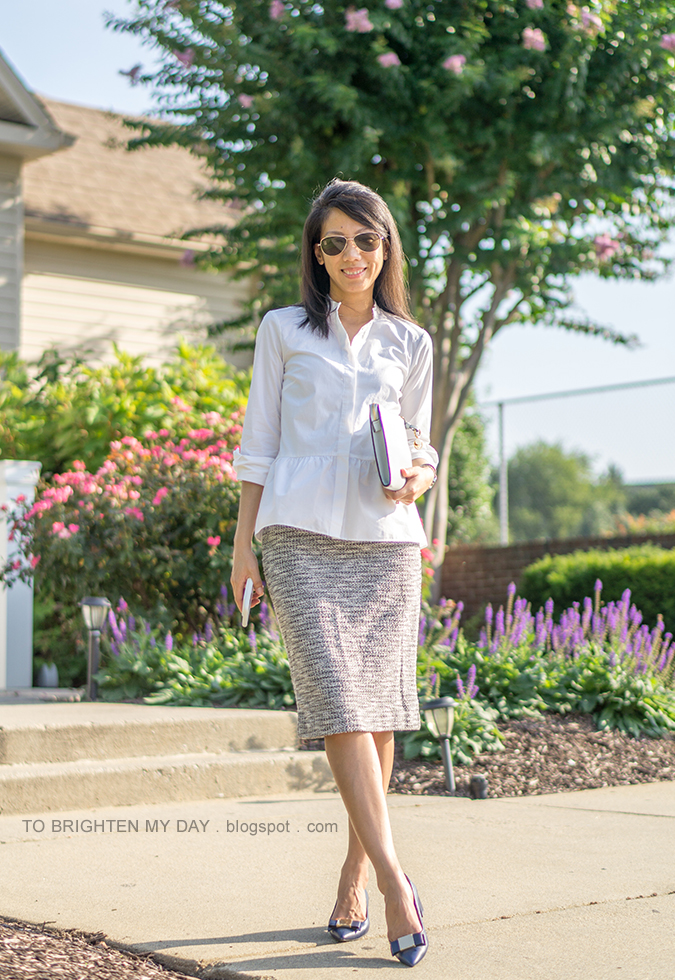 white peplum button up shirt, two tone watch, silver cuff, tweed pencil skirt, light blue clutch, navy bow pumps with block heel