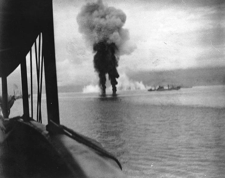 Smoke rises from two Japanese aircraft shot down off Guadalcanal on November 12, 1942. Photographed from USS President Adams; ship at right is USS Betelgeuse.