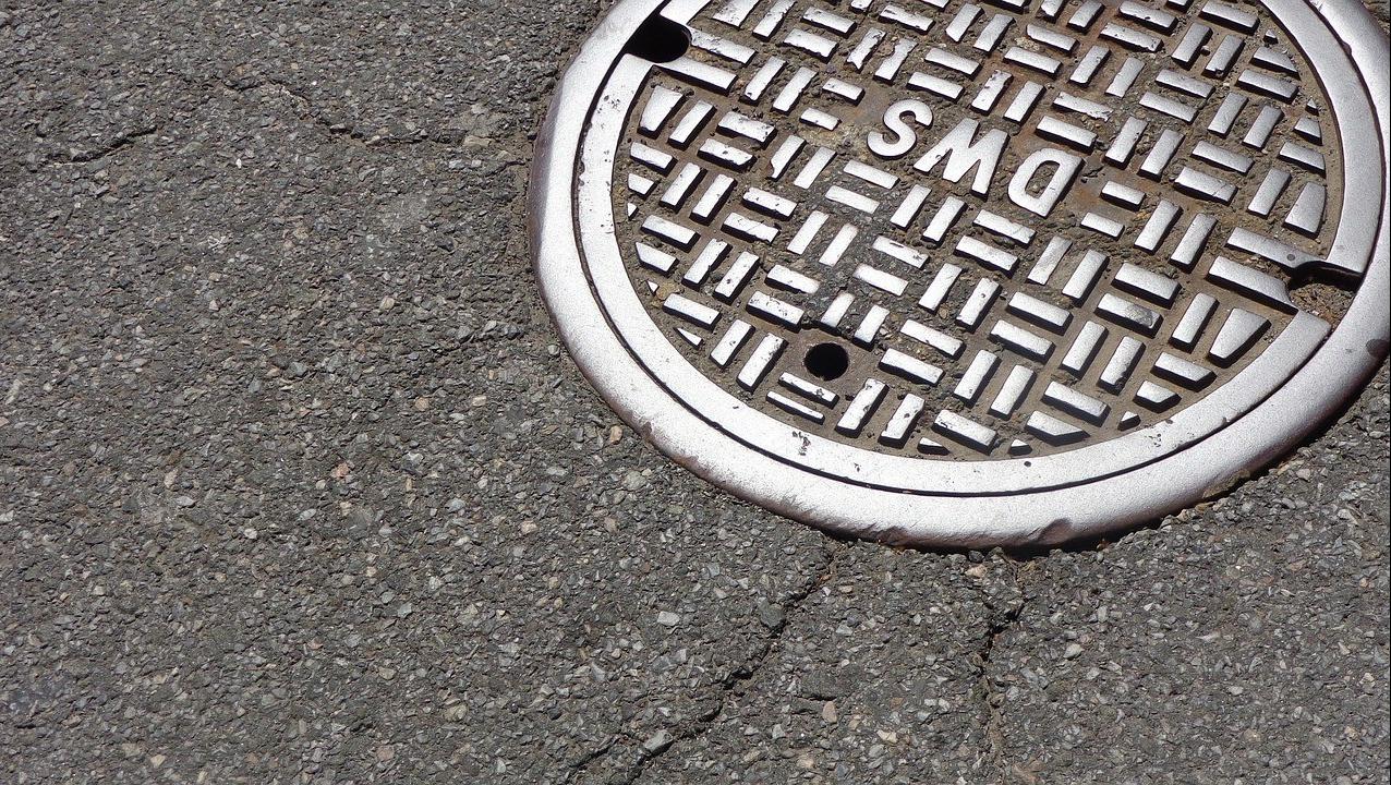 A manhole on a street.