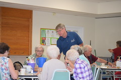 Rep. Ackert passes out his contact information to Columbia seniors during a legislative update.