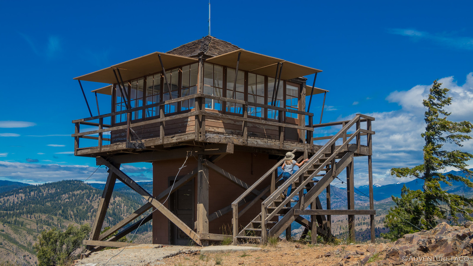 girl climbing stairs to fire lookout