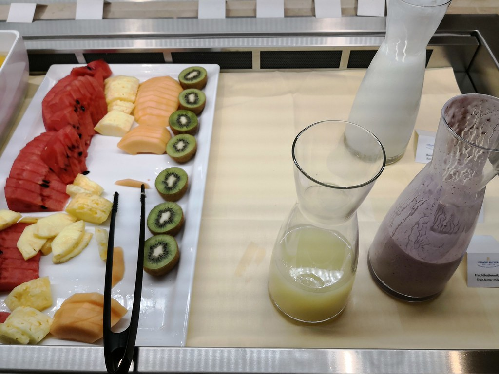 Sliced fresh fruits and smoothies
