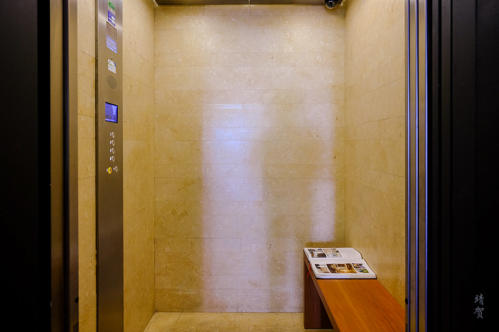 Elevator with a bench