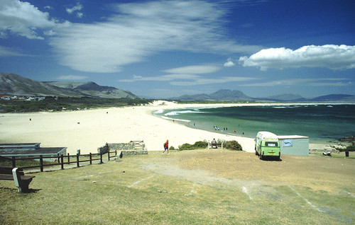 A van parked, looking over this beach ion South Africa