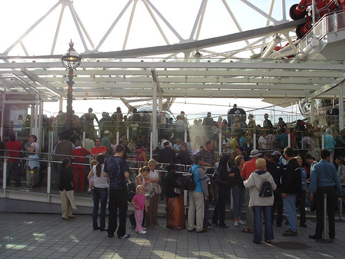 Queue at the London Eye by by cuttlefish on Flickr.  Used through Creative Commons.