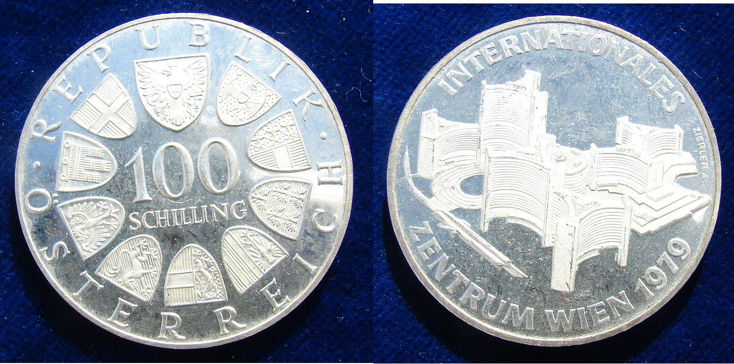 Austria 100 Schilling 1979 Vienna International Centre silver coin. 23.87 g Ag 0.640 = about 1/2 oz Fine Silver. Vienna International Centre. Value in 2 lines, and 10 shields around, surrounding: