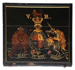 V R royal arms: anxious lion, lunatic unicorn