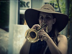 Under the hat is a trumpet and Rebecca Hennessy.