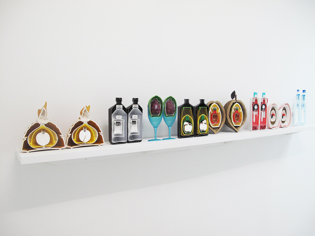shelf with series of reused plastic objects made to resemble fruit