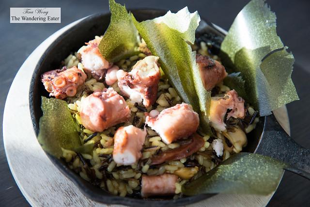 Octopus paella - seared octopus, PEI mussles, Seed to Sausage chorizo, aborio and wild rice, saffron stock, peas, dulse (or sea lettuce flakes)