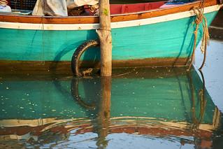 Thai fishing boat moored in a marina