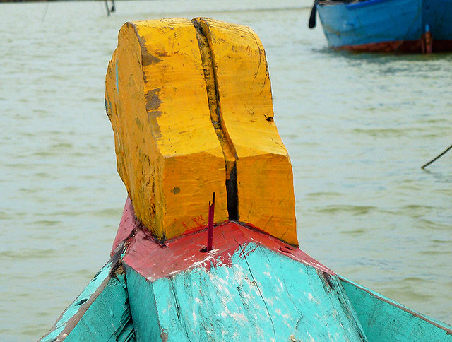 Prow of a boat on the Thu Bon River , much in the same way at happened during the days of the Champa Kingdom in Vietnam