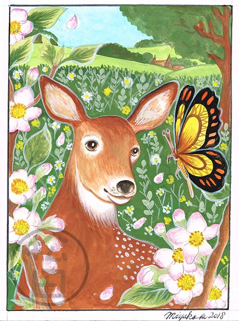 Deer with butterfly and apple blossoms in the countryside