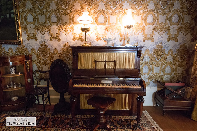 Piano in The Bleu Room; the living room in Manoir Papineu
